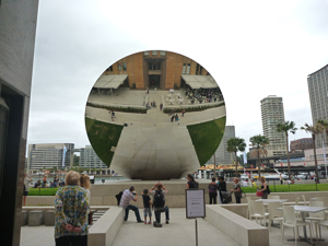 Sky Mirror 2006 by Anish Kapoor enjoyed from the back by tourists in Sydney