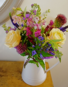 Jug with roses, agapanthus, mint, allium, snapdragon, stocks and veronica
