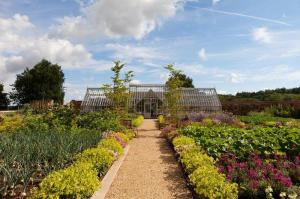 A bespoke greenhouse in an extensive walled garden