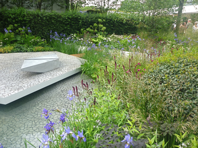 Clever cast concrete paving in Hugo Bugg's Waterscape Garden